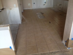Before removing the tile